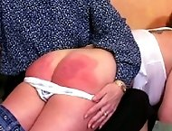 Two pretty teens spanked hard on their bare bottoms over the settee - heavily swollen buttocks